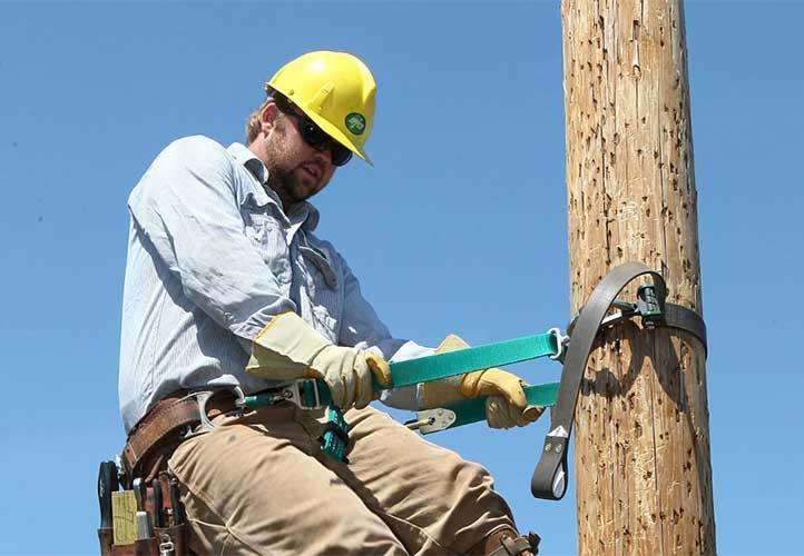 UPPCO worker climbing power pole